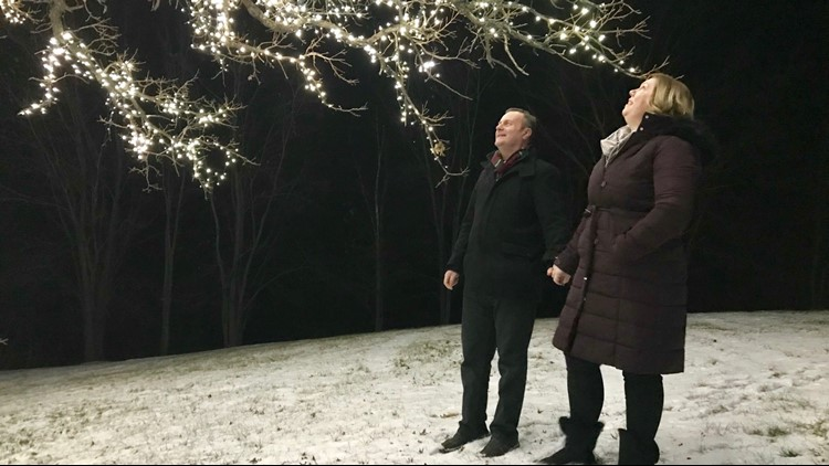 Andy and Lisa Black from Nottingham, England admire Jerry's tree