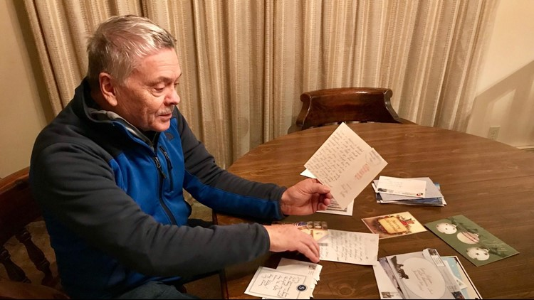 Jerry Lageson goes through mail thanking him for his tree lights