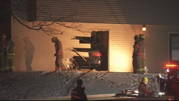 Car blasts through townhouse; man arrested
