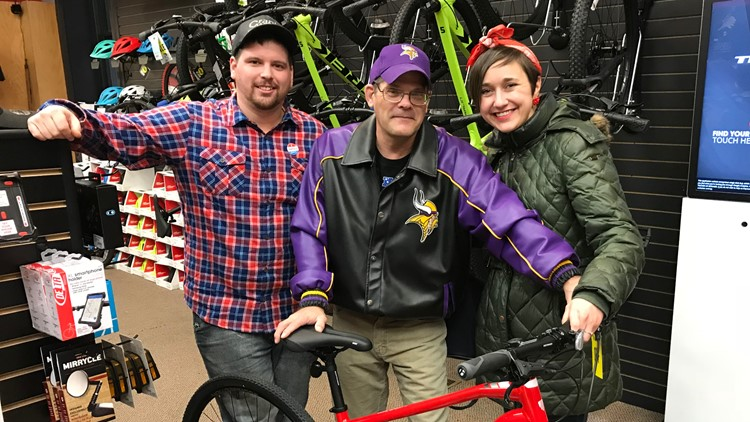 Ken Phillips (center) receives his new bike from the Francis Johnson Memorial Fund. Pictured with Issac Curtis and Elise Koop.