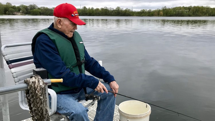 94-year-old Jim Clermont fishes of his dock on Lobster Lake in Garfield, Minnesota