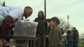 Twins players hand out baseball gloves to kids in Minneapolis and St. Paul