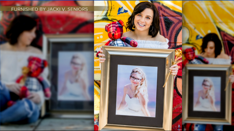 Haley Donley poses with a picture of Heather Doucette for her senior photo.