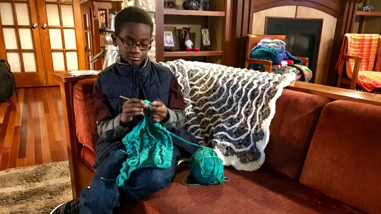 Eleven-year-old Jonah Larson crochets on his couch after school.