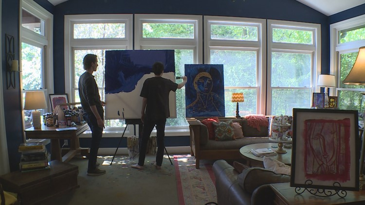 "James ""Jimmy"" Reagan, 24, has found a way to communicate past his regressive onset complex autism: painting. (Photo: Carly Danek, KARE 11)"