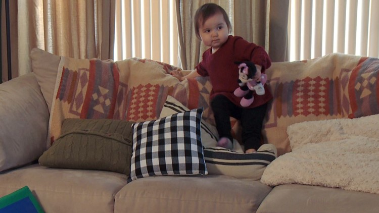 Maddy climbs furniture