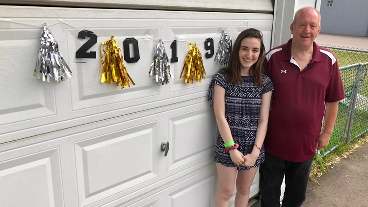 Jeff Nelson poses with Kylie Rybicki at her graduation party