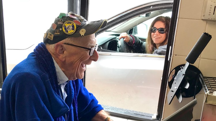 88-year-old Art Mason shares a laugh with a customer at the drive-thru of the Wayzata, Minnesota McDonald's