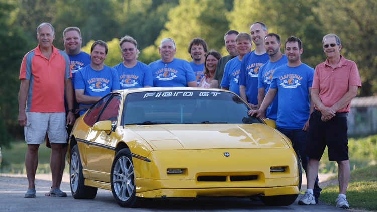 Members of the Tyler Shipman build team pose for a photo, 10 years after they restored the dying teen's prized Pontiac Fiero.