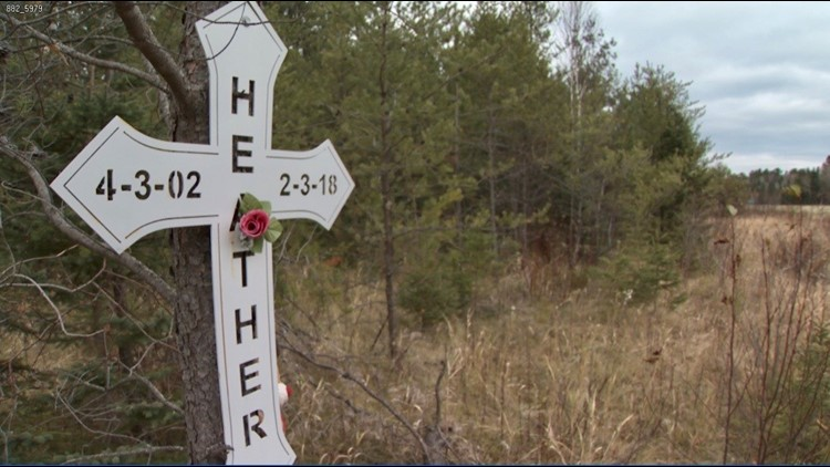 A cross marks the location along I-35 south of Cloquet where Heather Doucette died.