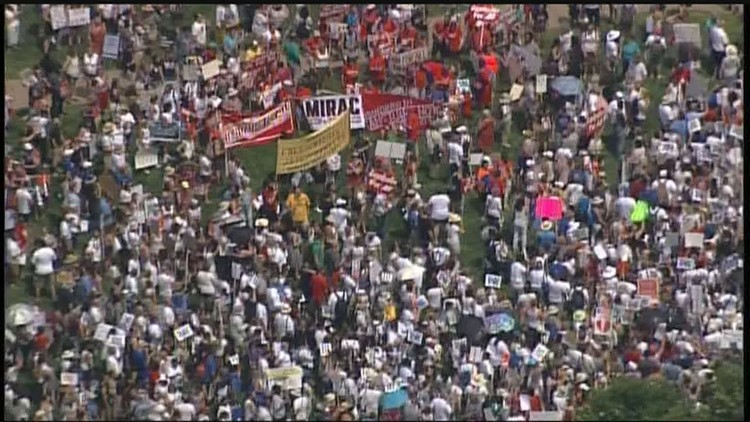 Thousands of protesters gathered outside the Minneapolis Convention Center on Saturday, joining groups across the country to march for families separated at the border. (Photo: SKY 11)