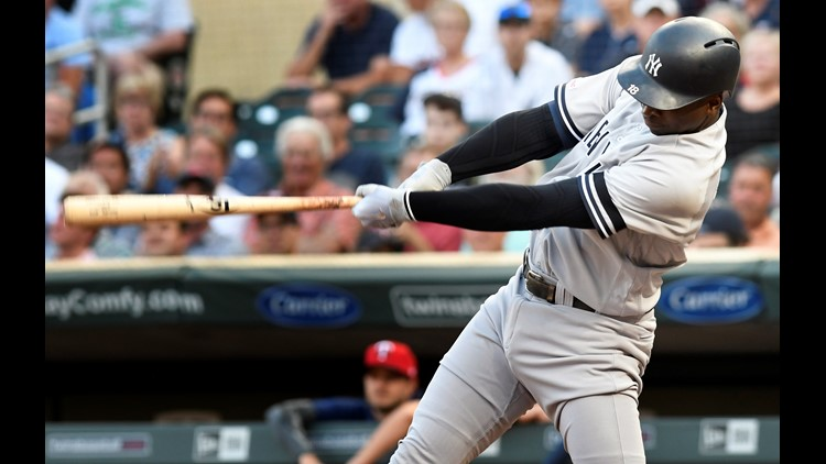 Yankees outslug Twins in extra innings