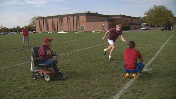 Larry Sanftner instructs Northfield's high school kickers during practice.