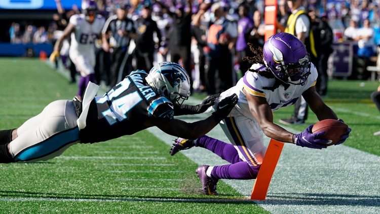 Cousins throws TD pass in OT; Vikes beat Panthers 34-28