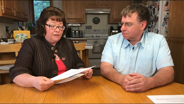 Trish and Steve Gingras, Gabby's parents, look over their insurance paperwork. (Photo: Boyd Huppert, KARE 11)