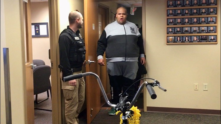A stunned Ty Burch walks into the River Falls, Wisconsin police station where he is surprised to find a new bike.
