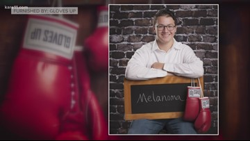 MN business uses boxing gloves to send unique message