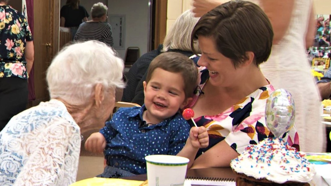 Fence friend Mary O'Neill celebrates 100th birthday with 2-year-old bestie by her side