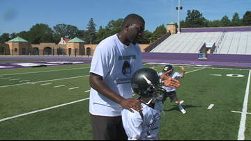 Vikings Stephen Weatherly instructs football camp