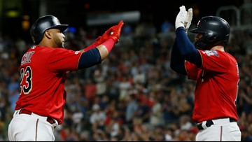 Cruz hits 2 of 4 homers by Twins in 8-5 win over Royals