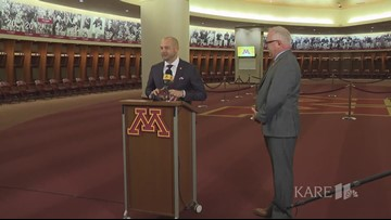 U of M coach Fleck presents Governor Walz with game ball