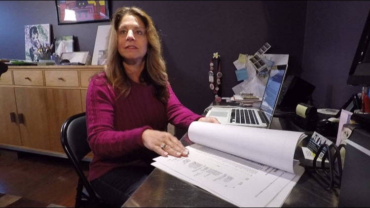 Marni Ribnick with some of her fraud paperwork.