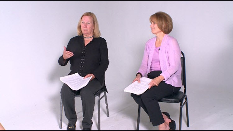 Kris Sundberg and Jean Peters hold the legislation they fought for during an interview with Lauren Leamanczyk.