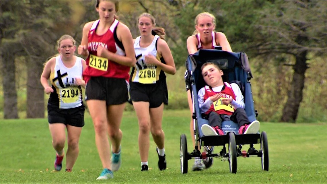14-year-old cross country runner pushes her big brother in a wheelchair so they can compete together