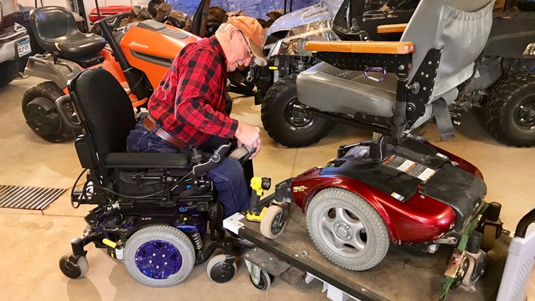 Bill Waldschmidt works on a power wheelchair