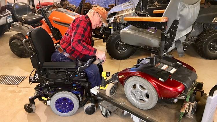 Bill Waldschmidt works on a power wheelchair