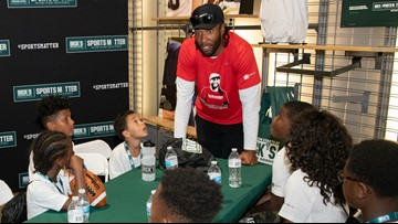 Larry Fitzgerald Jr. goes shopping with local kids