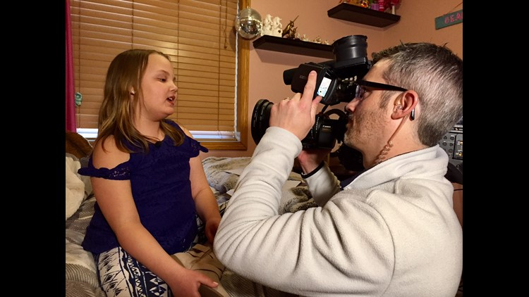 10-year-old Ruby Minder sings into a camera operated by KARE photojournalist Kevin Sullivan.  (Photo: Boyd Huppert, KARE 11)