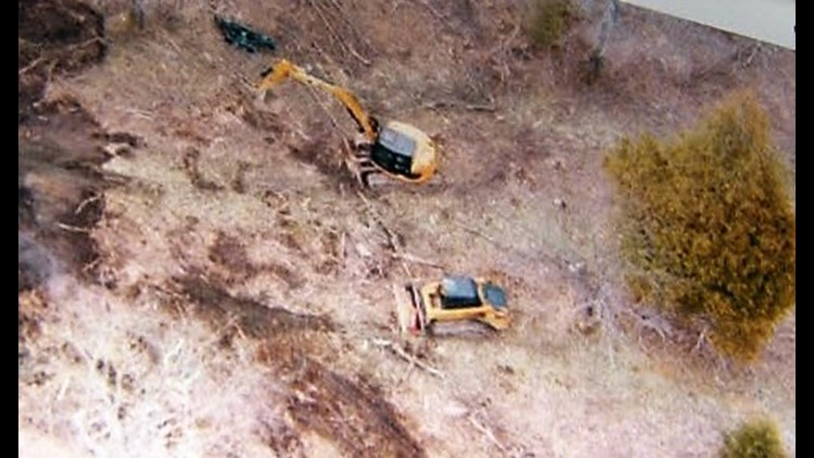 Aerial photo taken by Sam Brower shows excavation equipment on Jeffs' property.