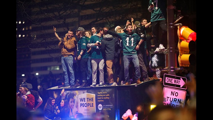 PHILADELPHIA, PA - FEBRUARY 04: Fans celebrate in Center City after the Philadelphia Eagles defeated the New England Patriots to win the Super Bowl on February 4, 2018 in Philadelphia, Pennsylvania. (Photo by Aaron P. Bernstein/Getty Images)