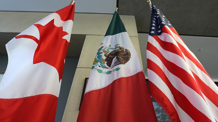 United States stocks surge to fresh records on NAFTA deal